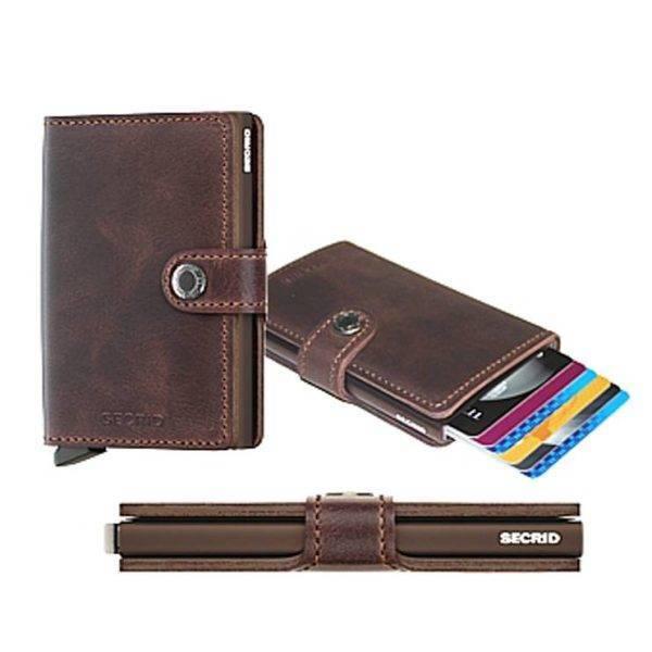 Tarjetero de piel vintage de color marrón oscuro y protector de banda magnética.
