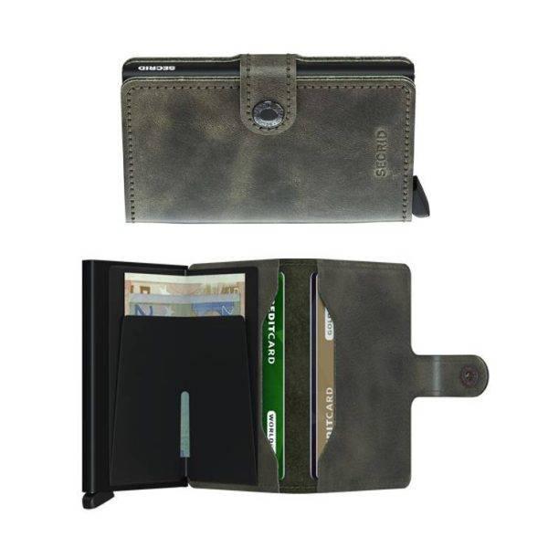 Tarjetero de piel vintage de color oliva y protector de banda magnética.