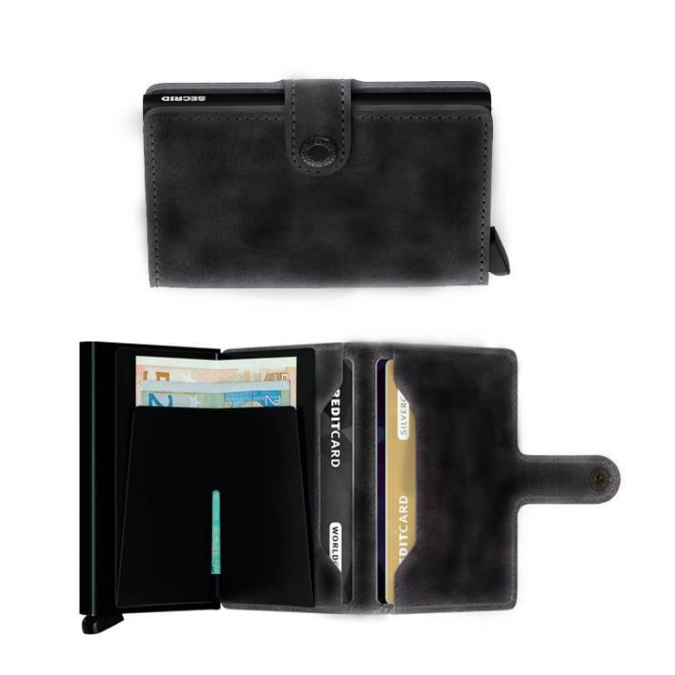 Targeter de pell vintage de color negrei protector de banda magnètica.