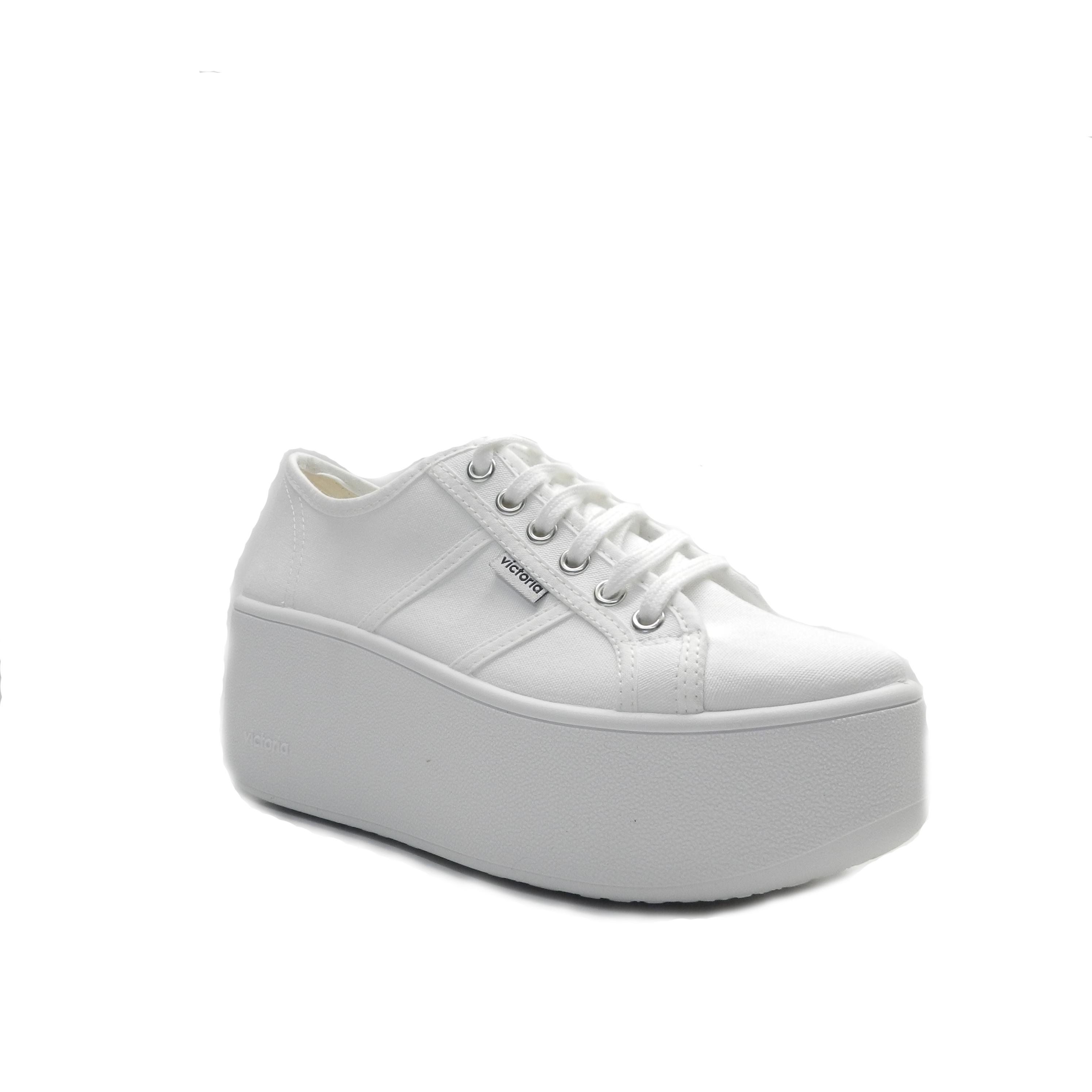 Sneakers de cordones y lona de color blanco con plataforma al tono