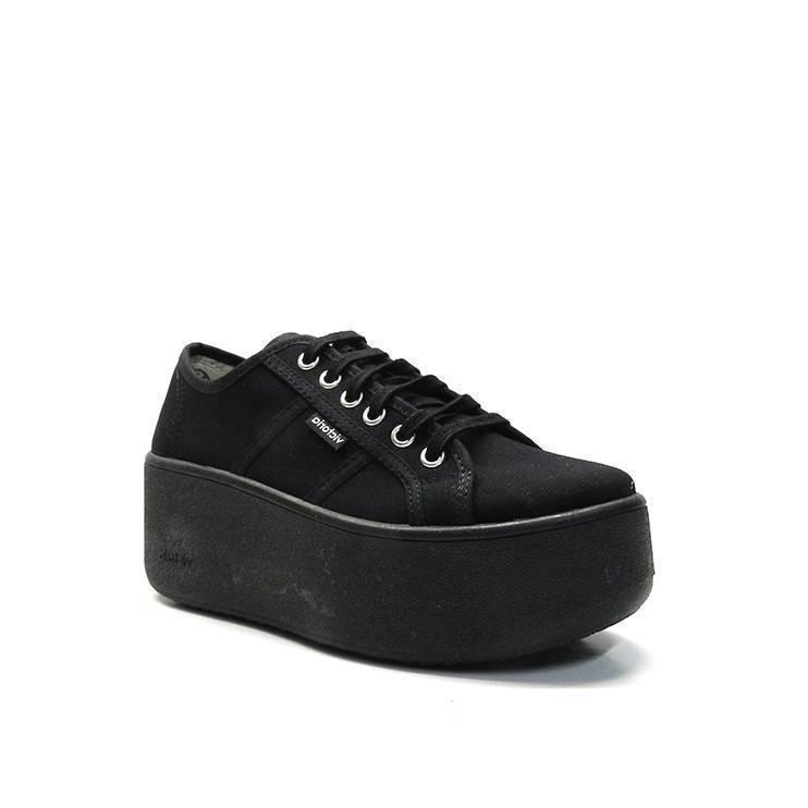 Sneakers de cordones y lona de color negro con plataforma al tono
