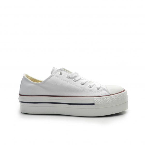 Sneakers de cordones y lona blanca con plataforma de la marca Victoria.