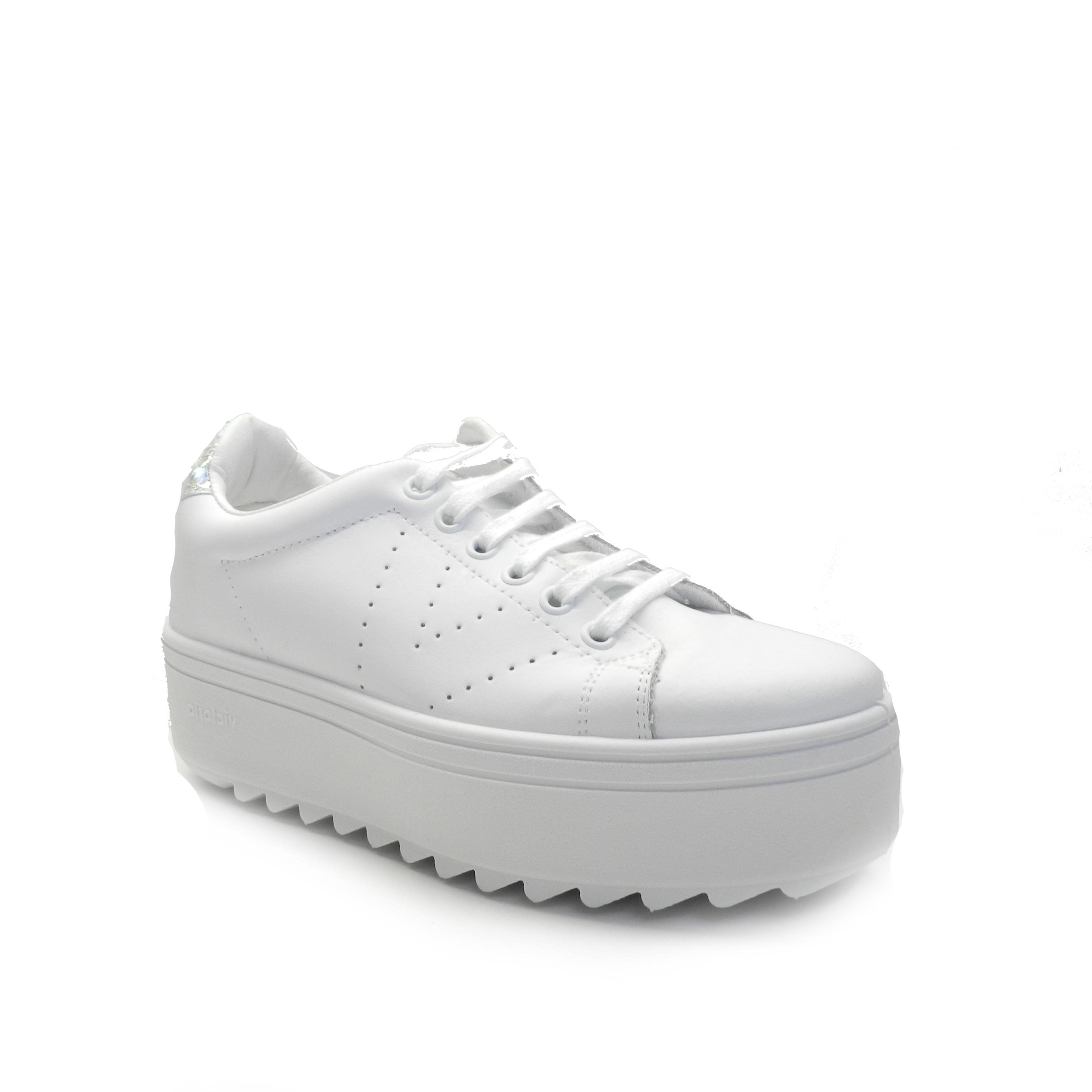 sneakers de napa en color blanco con plataforma dentada y cordones de la marca victoria.
